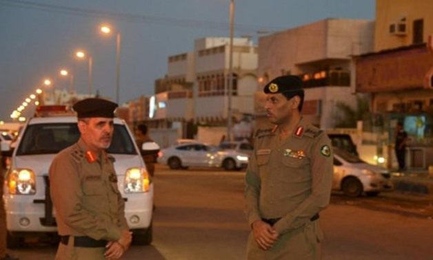 Members of Saudi security forces stand guard in the port city of Jazan - Reuters