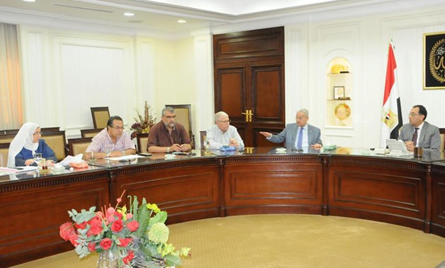 Madbouly during his meeting with Arab Contractors company's executives (Photo: courtesy of the official Facebook page of the Housing Ministry.)