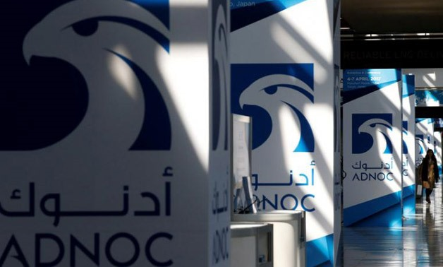 Logos of ADNOC are seen at Gastech, the world's biggest expo for the gas industry, in Chiba, Japan, April 4, 2017. REUTERS/Toru Hanai