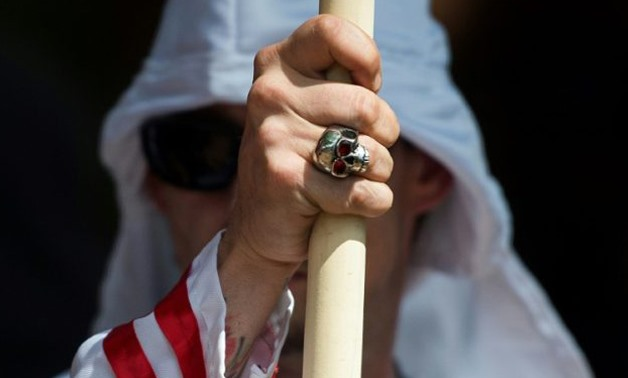 A member of the Ku Klux Klan looks on during a rally, calling for the protection of Southern Confederate monuments, in Charlottesville, Virginia on July 8, 2017. (AFP Photo/ANDREW CABALLERO-REYNOLDS)