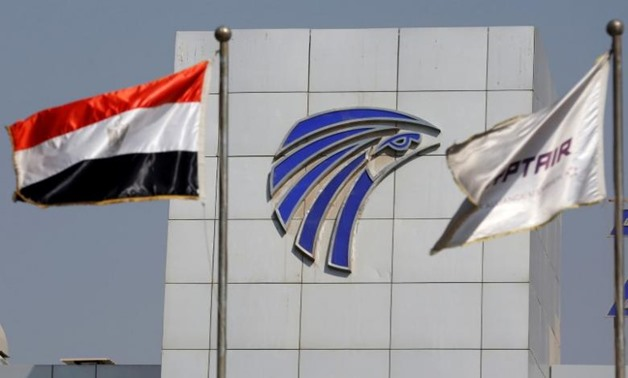 FILE- Egypt and EgyptAir flags are seen in front of an EgyptAir in-flight service building - Reuters