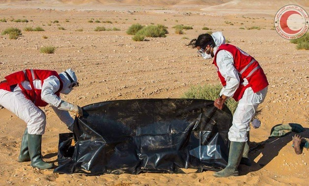Libyan Red Crescent forces recovering dead bodies - Courtesy of Libyan Red Crescent Via File Photo.