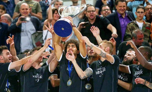 Amr Warda holding Greek Cup - Press image courtesy Amr Warda's official facebook account