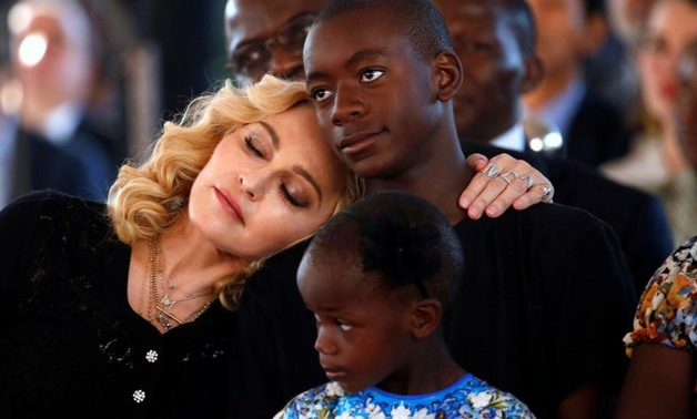 US singer Madonna embraces her adopted son, David Banda ahead of the opening of the Mercy James hospital in Blantyre, Malawi, July 11,2017. Reuters/Siphiwe Sibeko