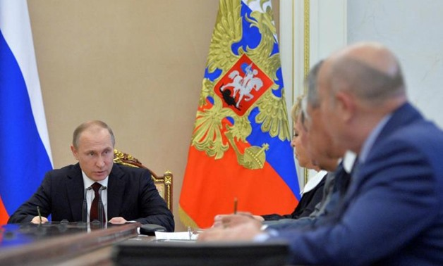 Russian President Vladimir Putin chairs a meeting with members of the Security Council at the Kremlin - Reuters
