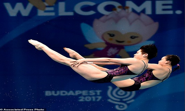 Qian Ren and Yajie Si of China compete in women's diving 10m synchronized platform final at the Swimming World Championships in Duna Arena in Budapest, Hungary, Sunday, July 16, 2017. (Zoltan Mathe /MTI via AP)
