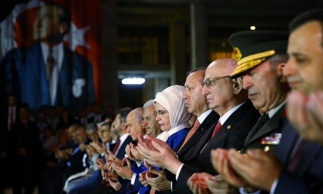 Turkish President Tayyip Erdogan and his wife Emine Erdogan pray during a ceremony marking the first anniversary of the attempted coup at the Parliament in Ankara, Turkey July 16, 2017. Kayhan Ozer/Presidential Palace/Handout via REUTERS