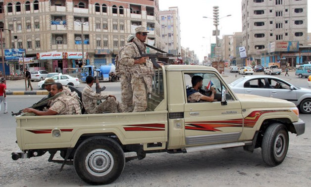 Yemeni Army soldiers patrol a street in Mansoura District, in Aden - Reuters
