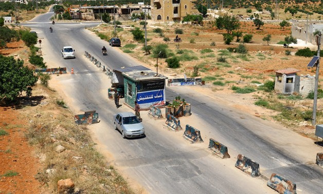 "Members from a coalition of rebel groups called ""Jaish al Fateh"", also known as ""Army of Fatah"" (Conquest Army), man a checkpoint in Idlib city"