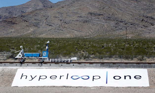 A sled recovery vehicle moves a test sled back to the starting position following a propulsion open-air test at Hyperloop One in North Las Vegas - Reuters