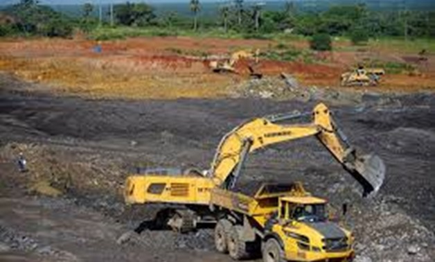 An excavator loads a truck at an area being prepared to be used by the lead and zinc mine Castellanos in Minas de Matahambre, Cuba, July 20, 2017.