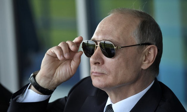 Russian President Vladimir Putin watches a display during the MAKS 2017 air show in Zhukovsky, outside Moscow, Russia July 18, 2017. Sputnik/Alexei Nikolsky/Kremlin via REUTERS ATTENTION EDITORS - THIS IMAGE WAS PROVIDED BY A THIRD PARTY
