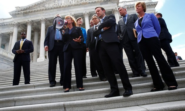 Senate Democrats gather on the Senate steps with protesters on Capitol Hill in Washington - REUTERS