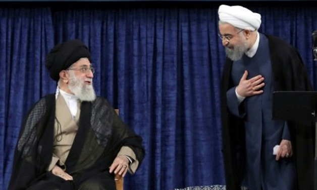 © IRANIAN SUPREME LEADER'S WEBSITE/AFP / by Eric RANDOLPH and Siavosh Ghazi | Iranian President Hasan Rouhani (R) speaks with supreme leader Ayatollah Ali Khamenei during his swearing-in on August 3, 2017