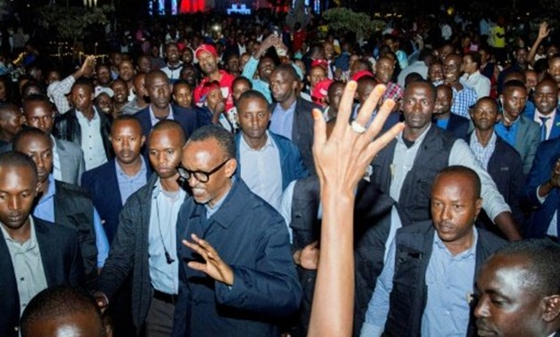 © AFP / by Stephanie AGLIETTI   Rwandan President Paul Kagame (C) celebrated his reelection with supporters in Kigali on Saturday