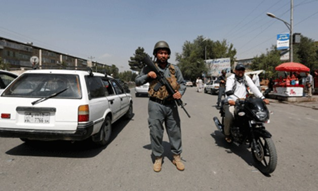 An Afghan police officer inspects vehicles at a checkpoint in Kabul, Afghanistan August 6, 2017–REUTERS