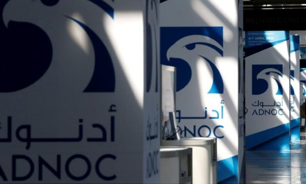 Logos of ADNOC are seen at Gastech, the world's biggest expo for the gas industry, in Chiba, Japan, April 4, 2017. Toru Hanai/File Photo