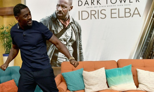 "Actor Idris Elba, seen here in a promotional appearance, is the star of ""The Dark Towers"" which topped the North American box office in its opening weekend - GETTY/AFP/File / Gustavo Caballero"