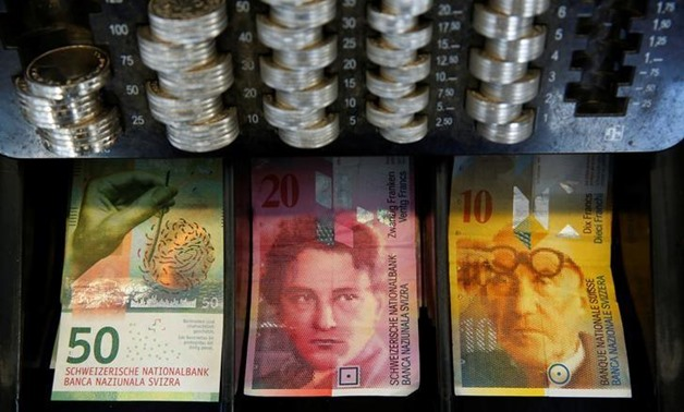 The new 50 Swiss Franc note is seen at a market stall after its release by the Swiss National Bank (SNB) in Bern, Switzerland April 12, 2016 - REUTERS