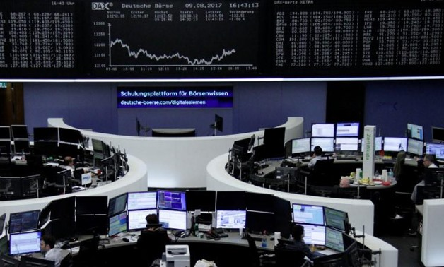 Traders work in front of the German share price index, DAX board, at the stock exchange in Frankfurt, Germany, August 9, 2017.