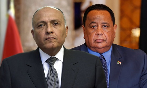 (L) Foreign Minister Sameh Shoukry, (R) Sudan's Foreign Minister Ibrahim Ghandour – File photo