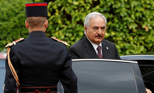 General Khalifa Haftar, commander in the Libyan National Army (LNA), arrives to attend a meeting for talks over a political deal to help end Libya's crisis in La Celle-Saint-Cloud near Paris, France, July 25, 2017. REUTERS/Philippe Wojazer