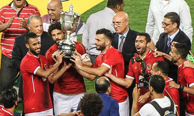 Al Ahly  players with the Egyptian Cup– Press image courtesy FIFA' official Twitter account.
