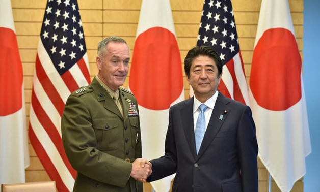 General Joseph Dunford (L), the chairman of the U.S. Joint Chiefs of Staff, shakes hands with Japan's Prime Minister Shinzo Abe at Abe's official residence in Tokyo, Japan August 18, 2017. REUTERS