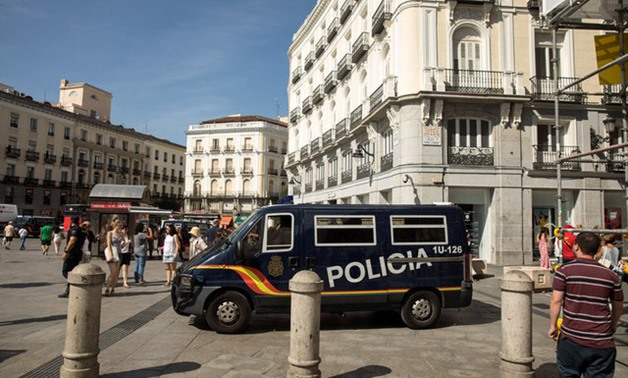 A police van drives by at Madrid's Puerta del Sol square - -REUTERS