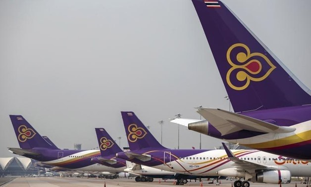 Thai Airways aircraft are parked on the tarmac at Bangkok's Suvarnabhumi International Airport March 27, 2015 - reuters