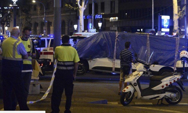 The van that ploughed into the crowd, killing 13 people and injuring around 100 others, is towed away from La Rambla in Barcelona AFP/Getty Images