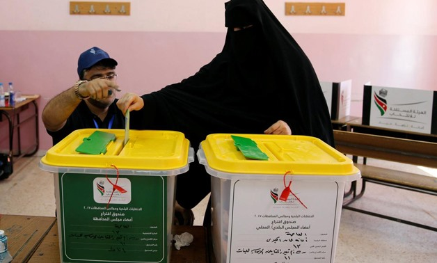 A Jordanian woman casts her ballot at a polling station for local and municipal elections in Amman, Jordan, August 15, 2017-Reuters