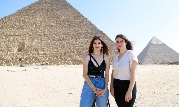Shyma and Ata at the pyramids on their second day of the tour