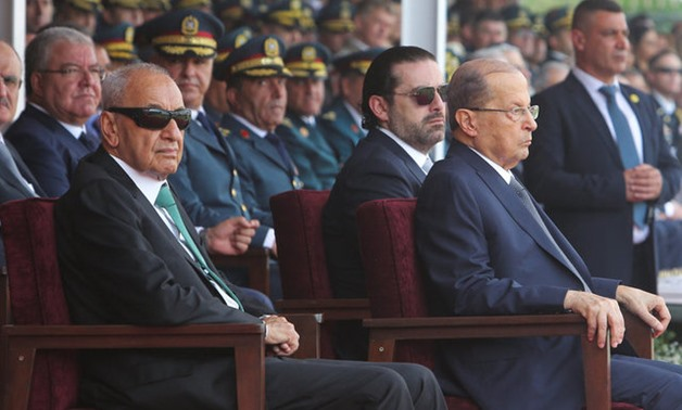 Lebanon's President Michel Aoun, Lebanon's Prime Minister Saad al-Hariri and Parliament Speaker Nabih Berri attend a graduation parade for Lebanese officer cadets at a military academy marking the 72nd army day in Fayadyeh - REUTERS