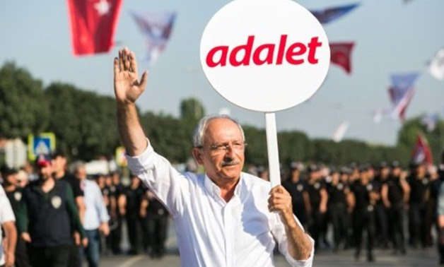 "© AFP / by Fulya OZERKAN | Turkey's main opposition Republican People's Party (CHP) leader Kemal Kilicdaroglu, pictured holding a placard that reads ""Justice"" at the end of a 450 kilometre protest march from Istanbul to Ankara in July"
