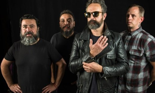 © AFP / by Natalia Cano | (L-R) Micky Huidobro, Paco Ayala, Tito Fuentes and Randy Ebright, members of the Mexican rock band Molotov, in Mexico City