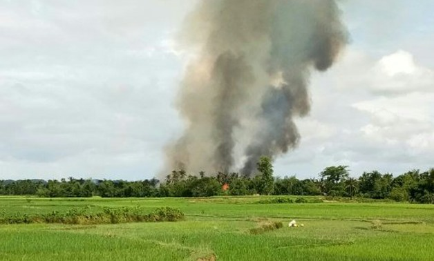 Smoke rises from what is believed to be a burning village near Maungdaw in Myanmar's Rakhine state AFP