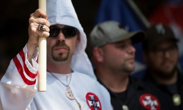 AFP/File | Supporters of the white supremacist Ku Klux Klan hold a rally in Charlottesville, Virginia on July 8, 2017
