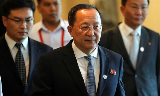 North Korean Foreign Minister Ri Yong Ho departs from his hotel to attend the 50th Association of Southeast Asian Nations (ASEAN) closing ceremony in metro Manila - REUTERS