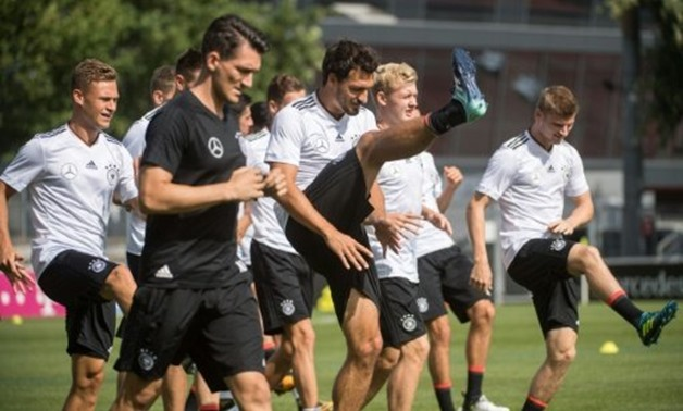 German national football team warm up during a training sessin in Stuttgart on August 30, 2017, ahead of their 2018 FIFA World Cup qualifier match against Czech Republic in Prague