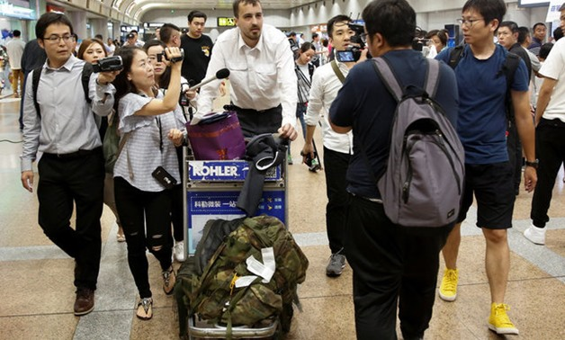 U.S. tourist Nicholas Burkhead speaks to the media after he arrived from Pyongyang at the airport in Beijing - REUTERS