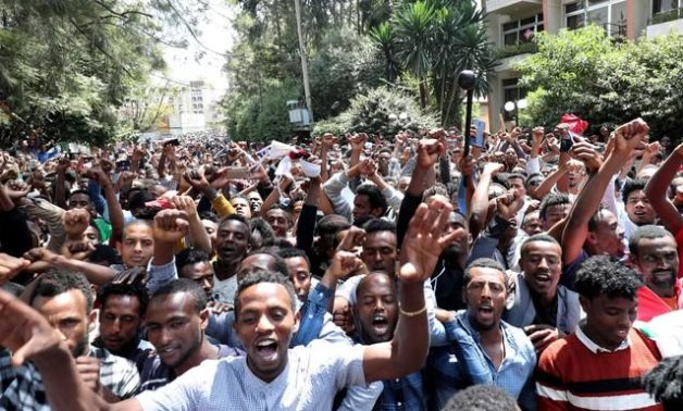 Oromo youth shout slogans outside Jawar Mohammed's house, an Oromo activist and leader of the Oromo protest in Addis Ababa, Ethiopia October 23, 2019. REUTERS/Tiksa Negeri