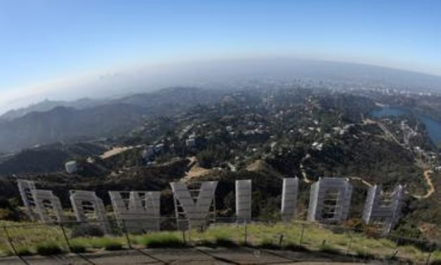 FILE PHOTO: Los Angeles is seen from behind the Hollywood sign in Los Angeles, California, U.S., August 14, 2019. REUTERS/Lucy Nicholson -/File Photo