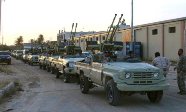Military vehicles of members of the Libyan GNA forces head out from Misrata to the front line in Tripoli, Misrata, Libya May 10, 2019. REUTERS/Ayman Al-Sahili