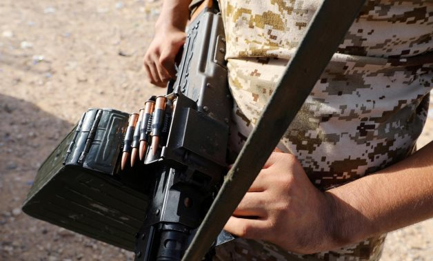 FILE PHOTO: A member of Libya's internationally recognised government forces carries a weapon in Ain Zara, Tripoli, Libya October 14, 2019. REUTERS/Ismail Zitouny/File Photo