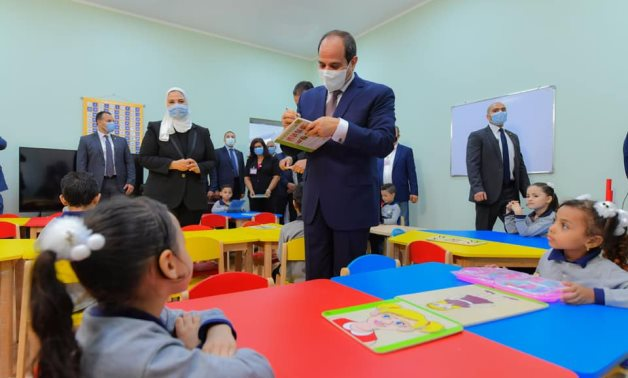 The president spoke lightly with children, signed some gifts before he handed them to the kids - Presidency
