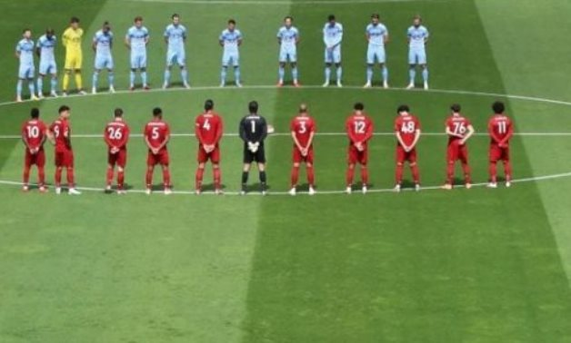 Players stand during a minutes silence in respect for the late Jack Charlton before the match,  via REUTERS/Phil Noble