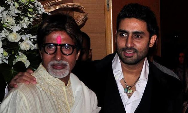 FILE PHOTO: Bollywood actors Amitabh Bachchan (L) and his son Abhishek Bachchan pose for a picture during a party of a new Bollywood production company in Mumbai February 28, 2010. REUTERS/Manav Manglani/
