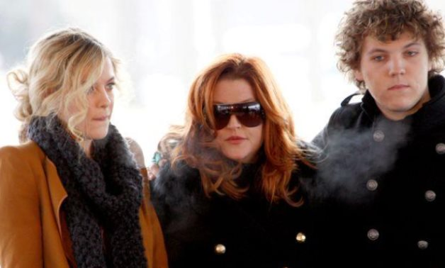 FILE PHOTO: Lisa Marie Presley, with her children Riley and Benjamin Keough, attend the 75th birthday celebration for Elvis Presley in Memphis, Tennessee January 8, 2010. REUTERS/Nikki Boertman/