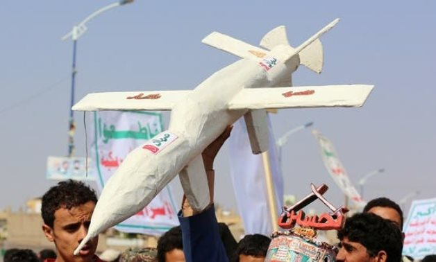 Followers of the Houthi movement carry a mock drone during a rally held to mark the Ashura in Saada. (File photo: Reuters)